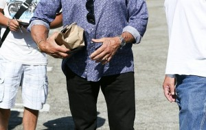 Sylvester Stallone, 70, looks a picture of health as he enjoys a stroll in Beverly Hills... after falling victim to online death hoax