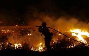 Brush fire burns more than 5,500 acres near Santa Clarita as ash and smoke fill skies