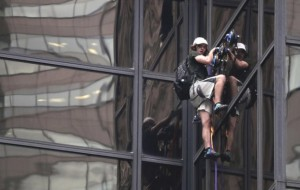 Police pull man climbing New York's Trump Tower through window to safety